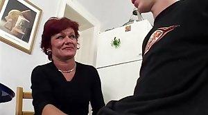 Redhead Mature Skank Sucking Young Boy's Cock
