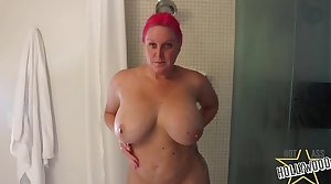 Spying on curvy milf showering