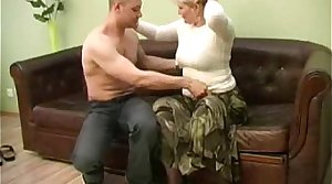 blonde mama and her young guy on sofa
